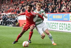 10/05/15 SCOTTISH PREMIERSHIP ABERDEEN v CELTIC PITTODRIE - ABERDEEN Aberdeen defender Shay Logan goes up against Stuart Armstrong (right)