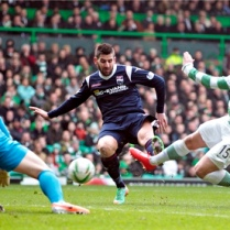 Celtic's Kris Commons, right, scores against Ross County in the Scottish Premiership at Celtic Park