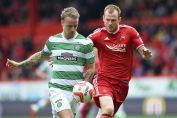10/05/15 SCOTTISH PREMIERSHIP ABERDEEN v CELTIC PITTODRIE - ABERDEEN Aberdeen's Mark Reynolds keep the pressure on Leigh Griffiths (left)
